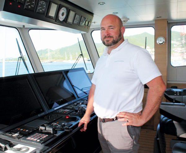Captain Brendan O'Brien on the bridge of Game Changer. Photo: Robert Luckock