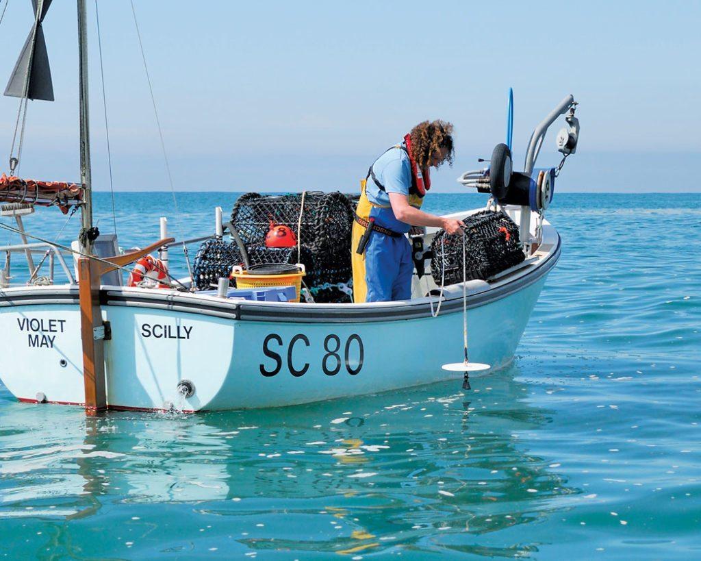 A fisherman deploys a Secchi Disk