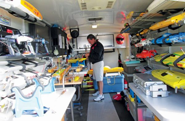 Busy at work in his mobile trailer modifying his collection of RC Boats that are ready to race