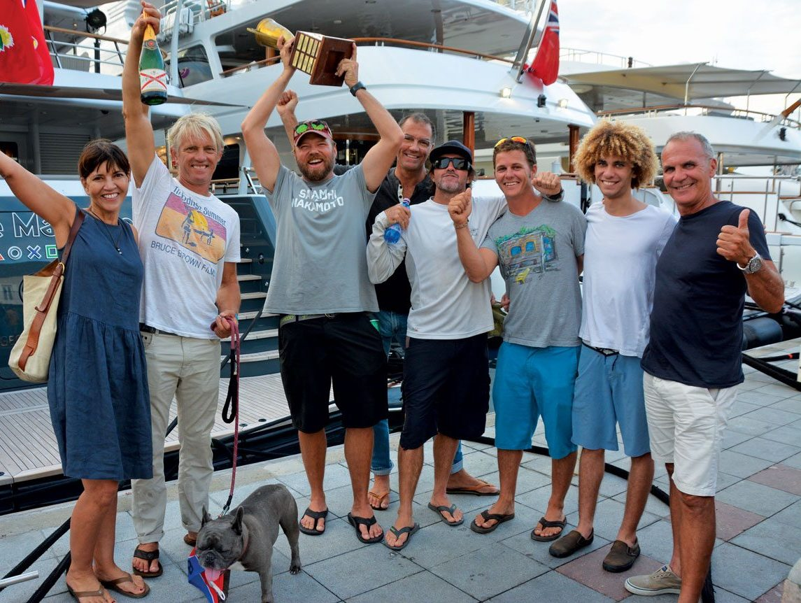 Lloyd Thornberg (with trophy) and crew celebrating their win in the 23rd annual New Year's Eve Regatta aboard the Gunboat 66 Phaedo. Photography Rosemond Gréaux