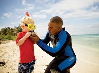 Getting ready for my first snorkeling adventure. Photo courtesy of Belize Tourism Board