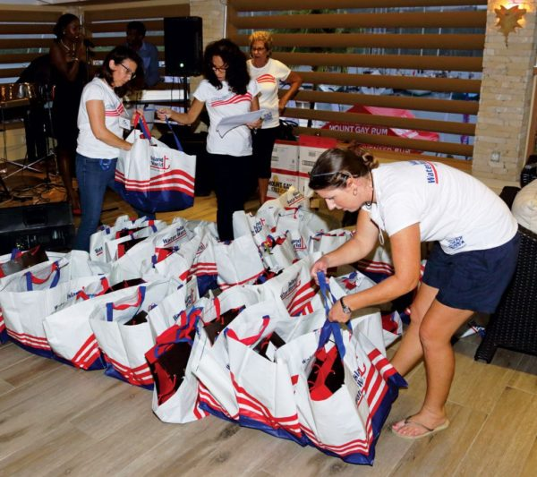 Sorting the coveted skippers' bags into classes to give out to the racers. Photo: Tim Wright / courtesy of Grenada Sailing Week