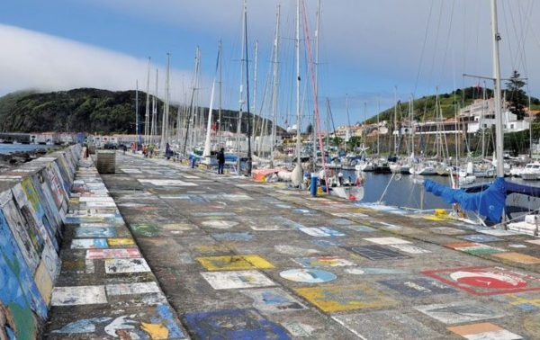 An enduring tradition – Paintings made by passing sailors completely cover the Marina's walls. Photo by Tiago Redondo