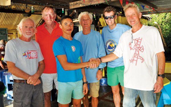 Sunfish veterans congratulate winner Darius Berenos. Photo by Els Kroon