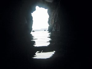 Looking out from a cave on Norman Island. Tortola can be seen in the background. Photo: Cemerp/Wikipedia