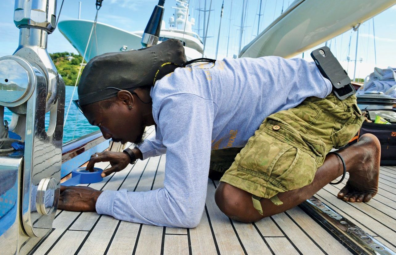 A steady hand – Gino Athill puts the finishing touches to his work on a J-Class yacht. Photo by Jan Hein