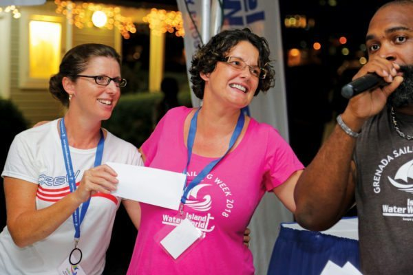 Regatta manager Karen (center) receives a 'Thank You' prize from Rosie Burr for all her hard work. Photo: Tim Wright / courtesy of Grenada Sailing Week