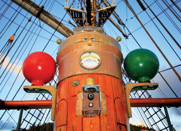 The ship's binnacle with iron correcting spheres at each side. Photo by Gary E. Brown