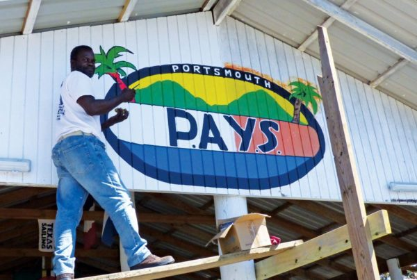 Reinstalling the PAYS sign and open for business. Photo: Macario Advantage