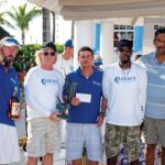 Captain Jono Jones (third right) and Team Legacy receive their Champion Boat Award. Photo: Leslie St John