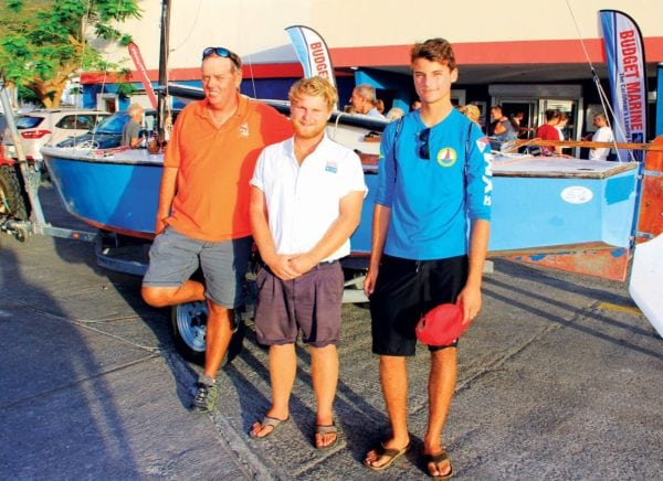 Bound for the Central American and Caribbean Games (from left): Garth Steyn, Jolyon Ferron and Alec Scarabelli alongside their recently acquired Lightning dinghy during the launch ceremony hosted by Budget Marine, St. Maarten. Photo by the Editor