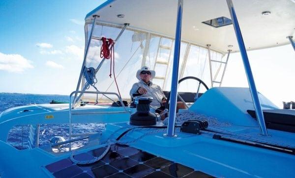 Robert at the helm station of their Lagoon 45 catamaran. Photo by Toni Erdman