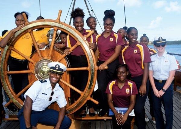 Ivanna Eudora Kean and Charlotte Amalie JROTC Cadets take the helm on a tour of Eagle. Photo: Dean Barnes