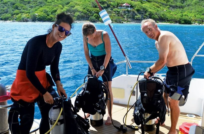 Captain Anna Orchard checks the equipment before a dive