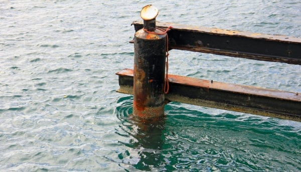You can get an idea about what the current is doing by looking at pilings or the way a buoy is behaving. Other things to consider when docking in current are the vessel's draft and keel configuration. Photo: OceanMedia