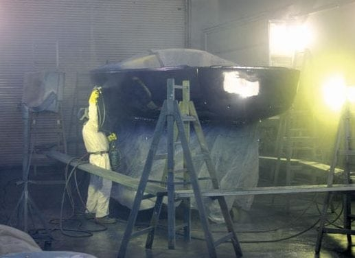 This is a rare image taken in the spray booth while the boat is being sprayed. Note how much overspray is in the air during the process. Rather than do this work myself, I had an expert painter spray the final coats.