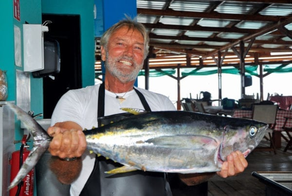 Gijs Boer proudly shows off a freshly caught yellowfin tuna. Photo by Els Kroon