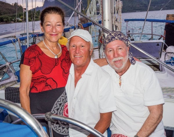 Andy and Julie Turpin join Fatty and Carolyn (Carolyn is slaving in the galley) aboard Ganesh at anchor in Cook's Bay