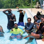 Pool time (front row, from left): Terell Hyndman, Marquis Aubain, Kia Campbell, Rajahni Flowers and Isis Brannigan. Standing are Ashonni Etienne (left) and Gary 'Tre' Danet