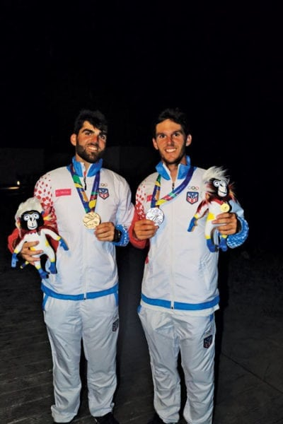 The Gonzalez Brothers, Manolo (crew) and Ramon (Skipper), with their medals