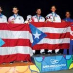 On the winners' podium (from left): the Gonzalez Brothers (Silver),Raul Andres Rios and Jose Arturo Diaz (Gold) and the Cuban Team (Bronze) of Rene Torrecillas and Carlos Exposito