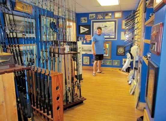 Capt. Randy Towe of Islamorada builds rods in his man cave/office at mile marker 92 bayside. Photo By Jill Zima Borski