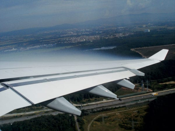 Condensate forming in low pressure area over a wing of an A340. Photo: Mgw89/Wikipedia