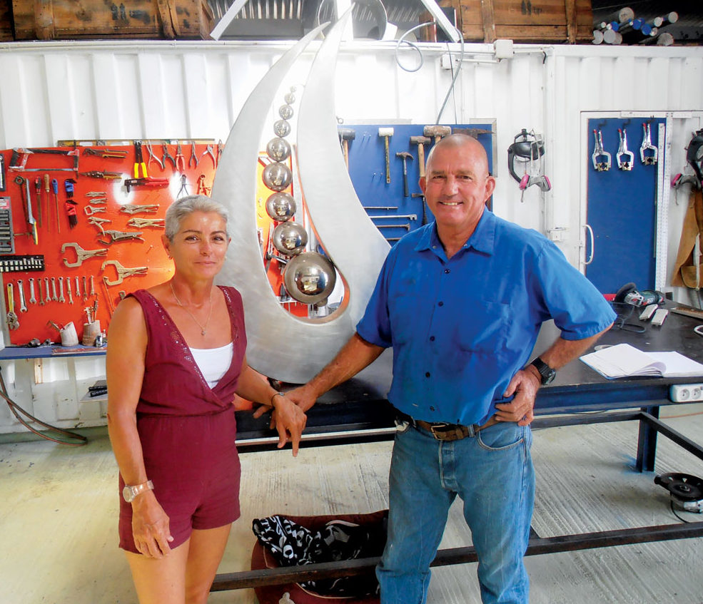 Mark and Carla in Mark's workshop, French St. Martin. Photo by Chris Morvan