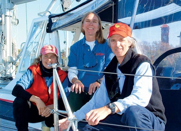 Miles and Anne Poor (center) with crew on Karina during their first Caribbean 1500