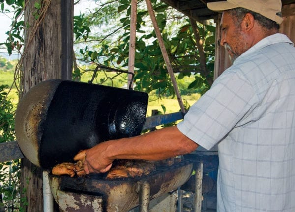 All kinds of ways to do jerk. Here in Saint Elizabeth they use oil barrel barbecues and forego the pimento sticks. Photography by Sharon Matthews-Stevens
