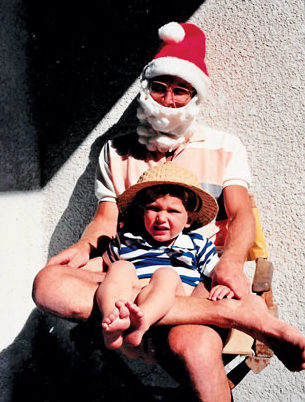 Santa and our son on our first cruising Christmas. Photography by Jan Hein