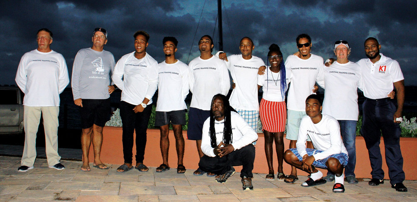 Students, tutors, organizers and sponsors pose for the camera at Aqua Mania before the graduation ceremony, Caribbean style. Photo by Gary Brown