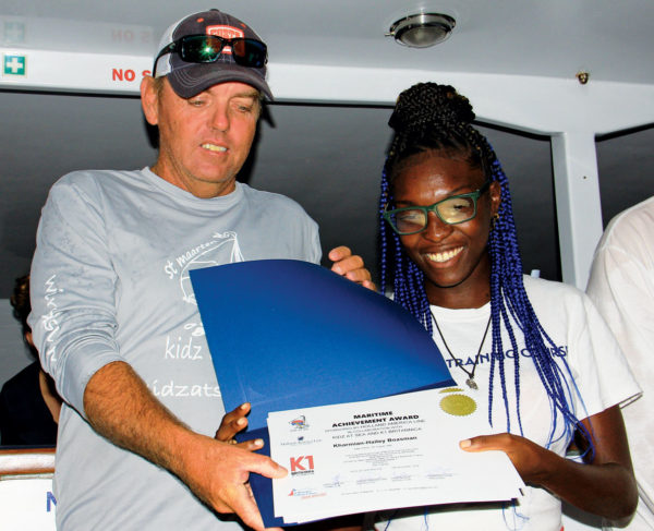 Kharmian-Hailey Boasman received her certificates from Garth Steyn during a sunset cruise to celebrate the students' graduation. Photo by Gary Brown