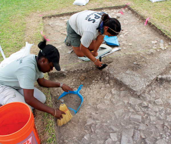 N'lyse and Michelle gently sift through the archeology at Christiansted Wharf. Photography courtesy of Dr. Meredith Hardy