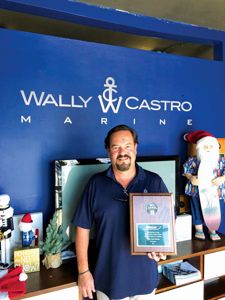 Wally Castro with his Sales Volume Award from Boston Whaler!