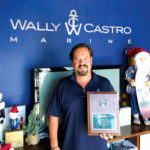 Wally Castro with his Top Sales Award from Boston Whaler