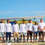 L-R, Vessel Maintenance Instructor Jon Westmoreland, Shaniah Singh, Edwin Brooks, Anthony Lalbachan, Elwin Christopher, Lamar Halley, Eury Albert, Kharmian Boasman, Sailing Instructor Tony Burns, Omar York, Khristopher Hinds