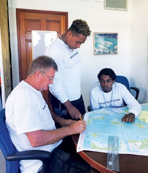 L-R Tony Burns, Eury Albert, Anthony Lalbachan, during a navigation course.