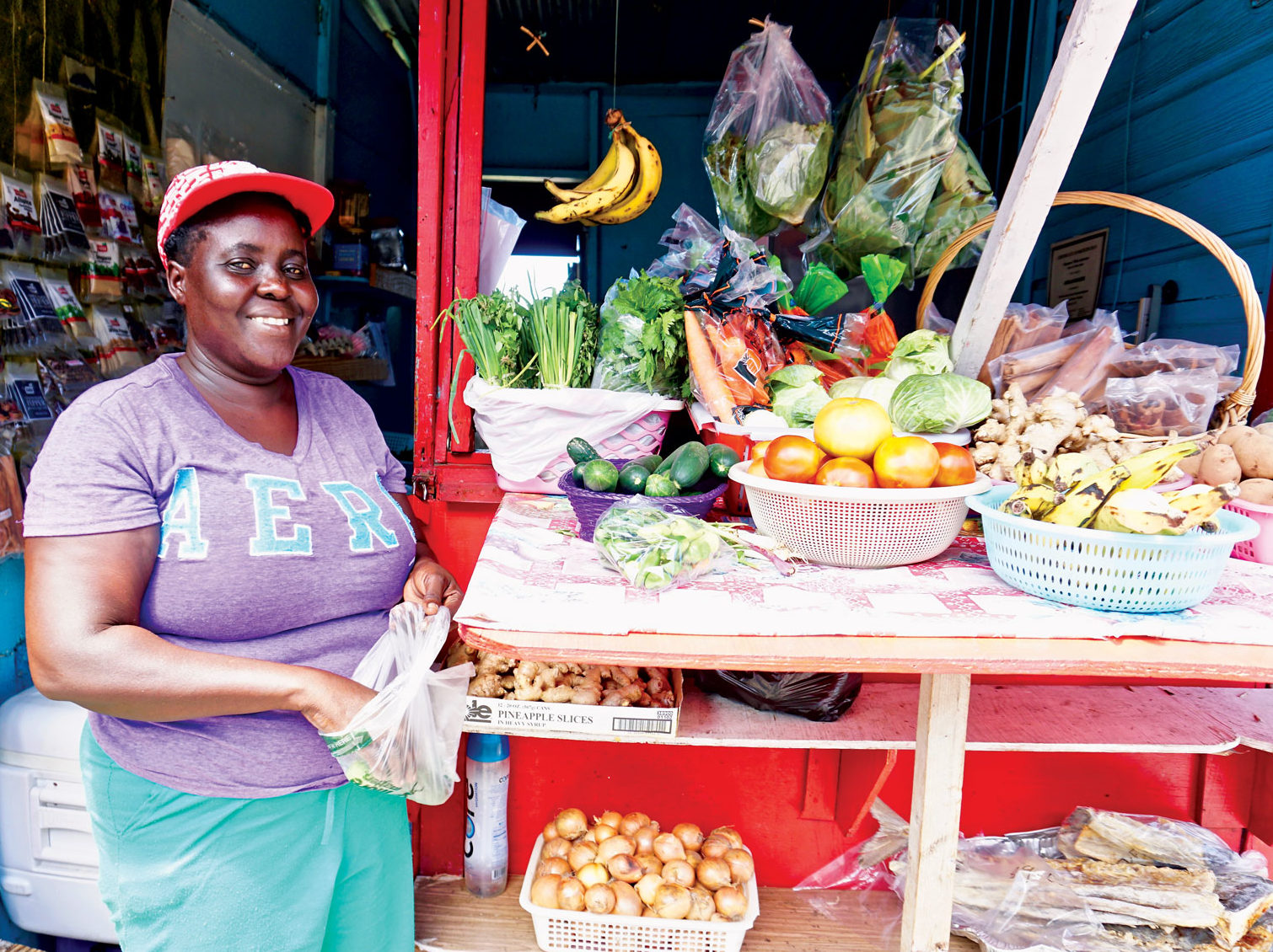 Lesley is always happy to help in Carriacou's Fruit Stand. Photo by Jan Hein
