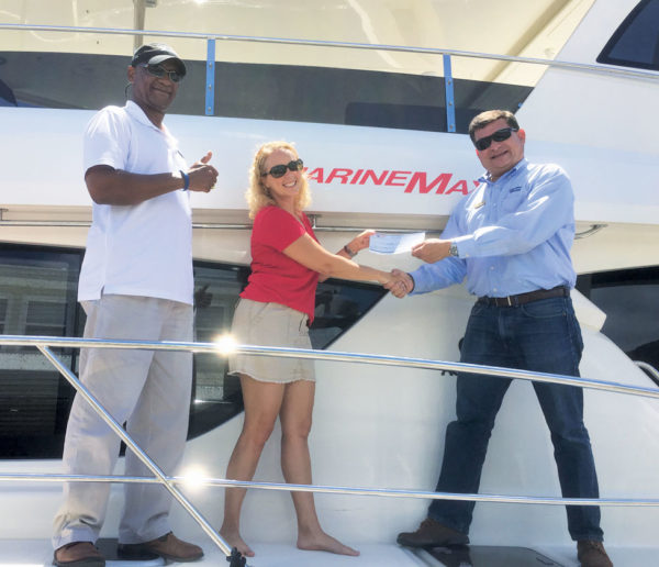 L to R: Clarence Malone, MarineMax Vacations BVI General Manager; Julie Schneider, operations manager with Virgin Islands Search & Rescue; Raul Bermudez, vice president, MarineMax Vacations. Courtesy: MarineMax