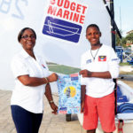 Louisa Norris, General manager Budget Marine Antigua and Shanoy Malone, member of Antigua and Barbuda's Optimist World Championship Team.