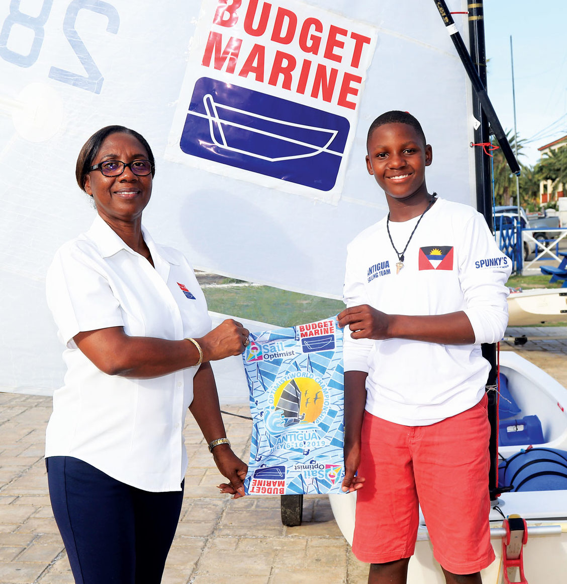 Louisa Norris, General manager Budget Marine Antigua and Shanoy Malone, member of Antigua and Barbuda's Optimist World Championship Team.