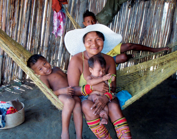 This happy Kuna family had several more kids in their basic hut, most of them with snotty noses and eye infections