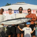 Photo: 2012 Virgin Islands Game Fishing Club's Wahoo Windup Winner. L to R: Clive Mahabir, Rob Richards, James MacNeil, Clay Gaffney and Sarah Faist, with Robbie Richards in front, stand with Mahabir's winning 91.8-pound wahoo officially weighed in by DPNR Fish & Wildlife personnel. Credit: Dean Barnes