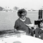 Fatty shows his mother his sailboat model-note gangplank for Ranger III on the dock.