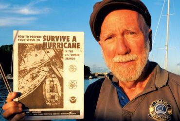 Cap'n Fatty Goodlander with his Surviving Hurricane Season Manual