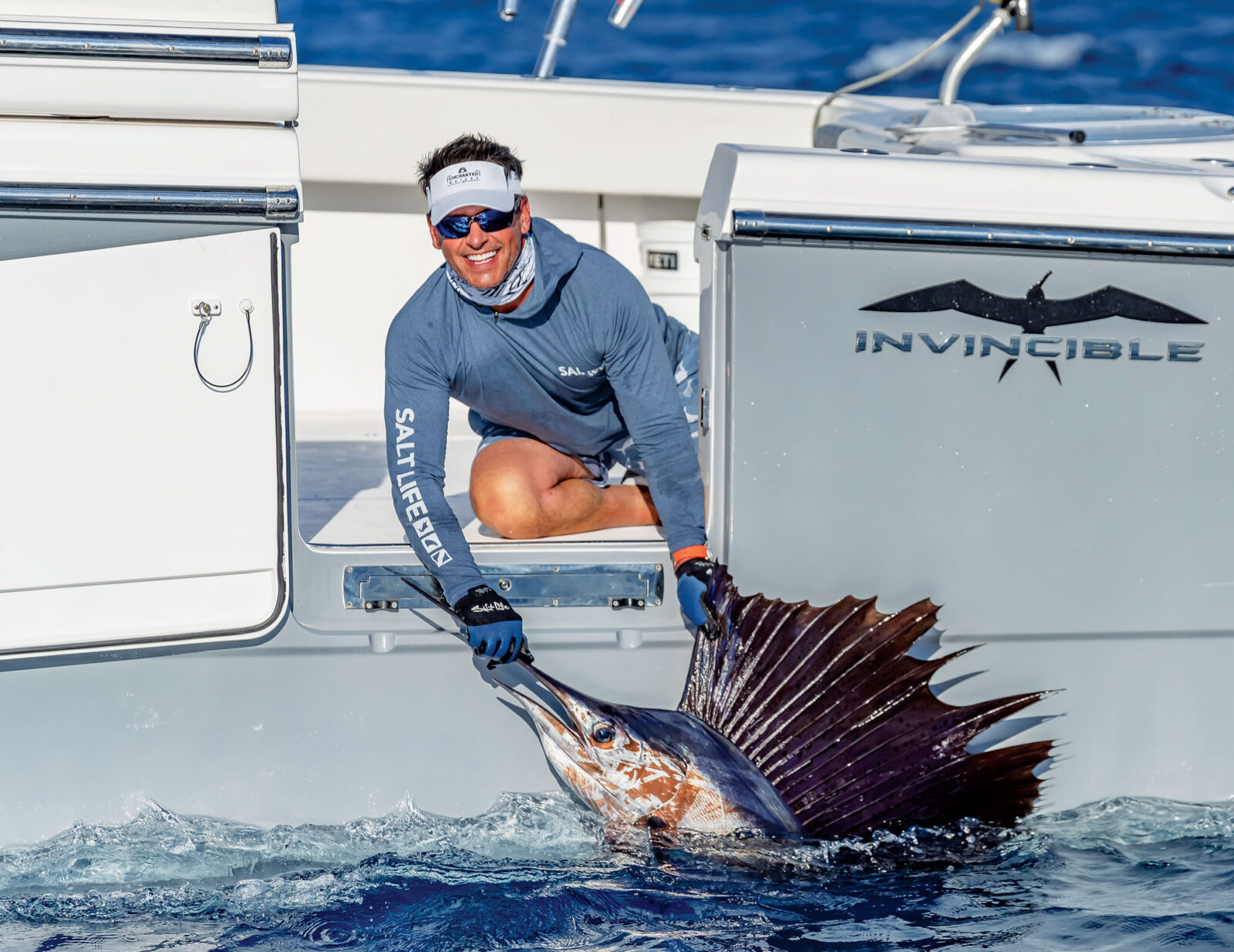 Image of fishermen with a sailfish on the back of an Invincible Power Boat