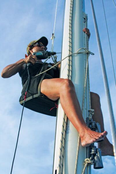 Carolyn installing sail track