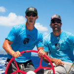 Shannon Falcone (R) giving Alex Sinclair (L) his first foiling experience on the helm (St. Barth's 2018)