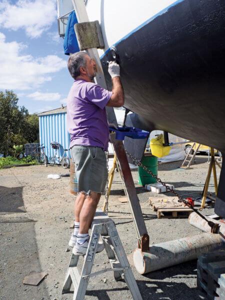 Joe Camuso helping paint Ganesh bottom in New Zealand—a true friend!!